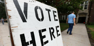 """Vote Here"" sign (Photo by Bill Pugliano/Getty Images)"