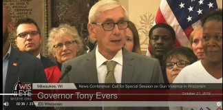 Gov. Tony Evers announces his call for a special session gun safety at City Hall in Milwaukee on Oct. 21, 2019 surrounded by supporters