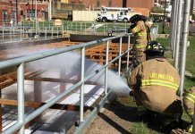 """Fire Department Training at WPCP"" by Arlington Department of Environmental Services is licensed under CC BY-NC 2.0"