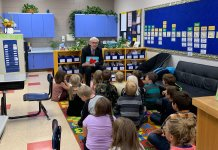 Gov. Tony Evers reads to school children. (Picture courtesy of Eves' office.)