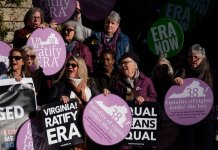 Supporters of the Equal Rights Amendment stand outside the entrance to the Virginia Capitol in Richmond on the opening day of the 2020 legislative session. | Ned Oliver/Virginia Mercury