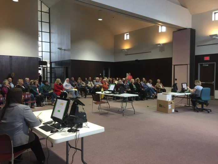 WEC staffers Michelle Hawley and Sara Linski train poll workers in Brookfield, Wis. in 2018