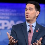 Scott Walker, hands out in front of him