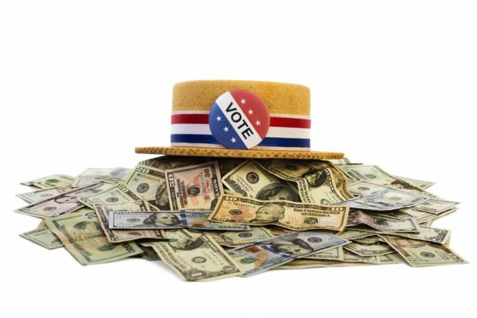 hat saying vote with piles of cash money