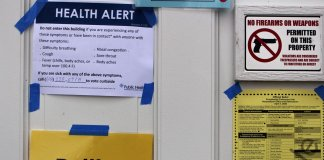 Signs from a pandemic election including health alert at the polls