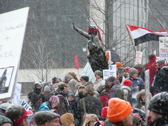 Statue of Lady Forward, blindfolded, in the snow during a February 2011 protest of Gov. Scott Walker's budget repair bill
