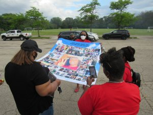Jay Anderson Jr's family unveils a custom made banner made up of various pictures of him. (Photo by Isiah Holmes)