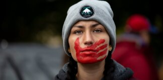 American Indian red hand over mouth protest of murdered and missing Indigenous women
