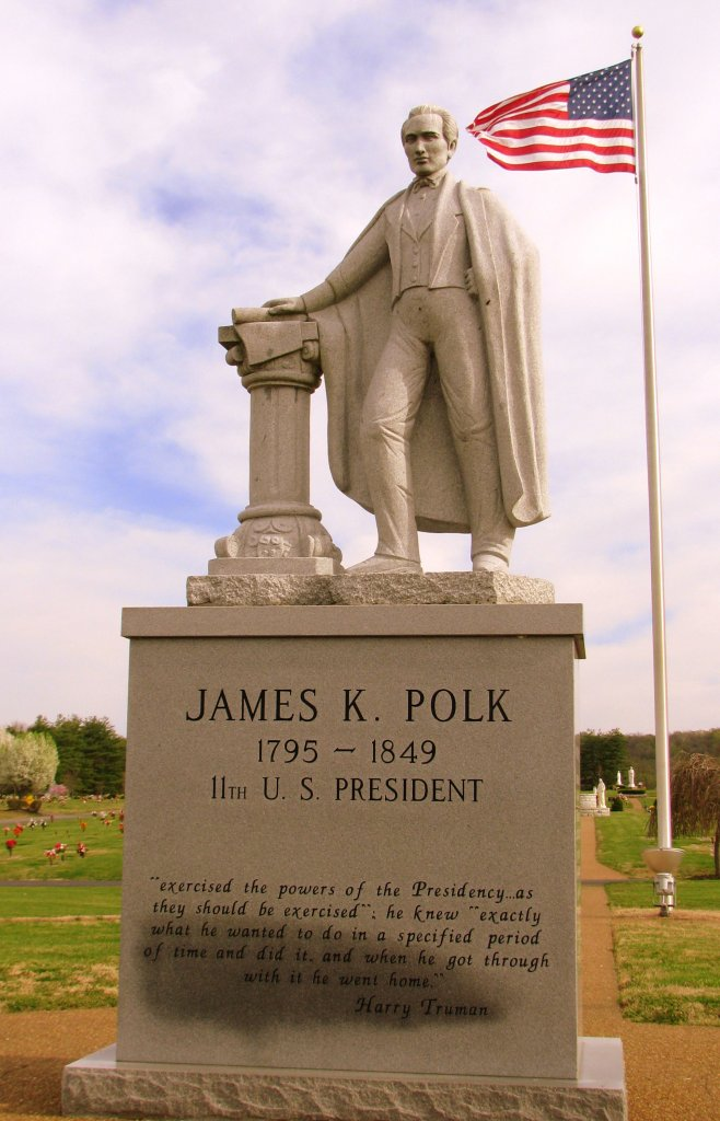 Statue of President James Polk with American flag in background