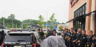 Wauwatosa officers form a line in front of May Fair Mall's Cheesecake Factory. A few protesters had just been arrested. (Photo by Isiah Holmes)