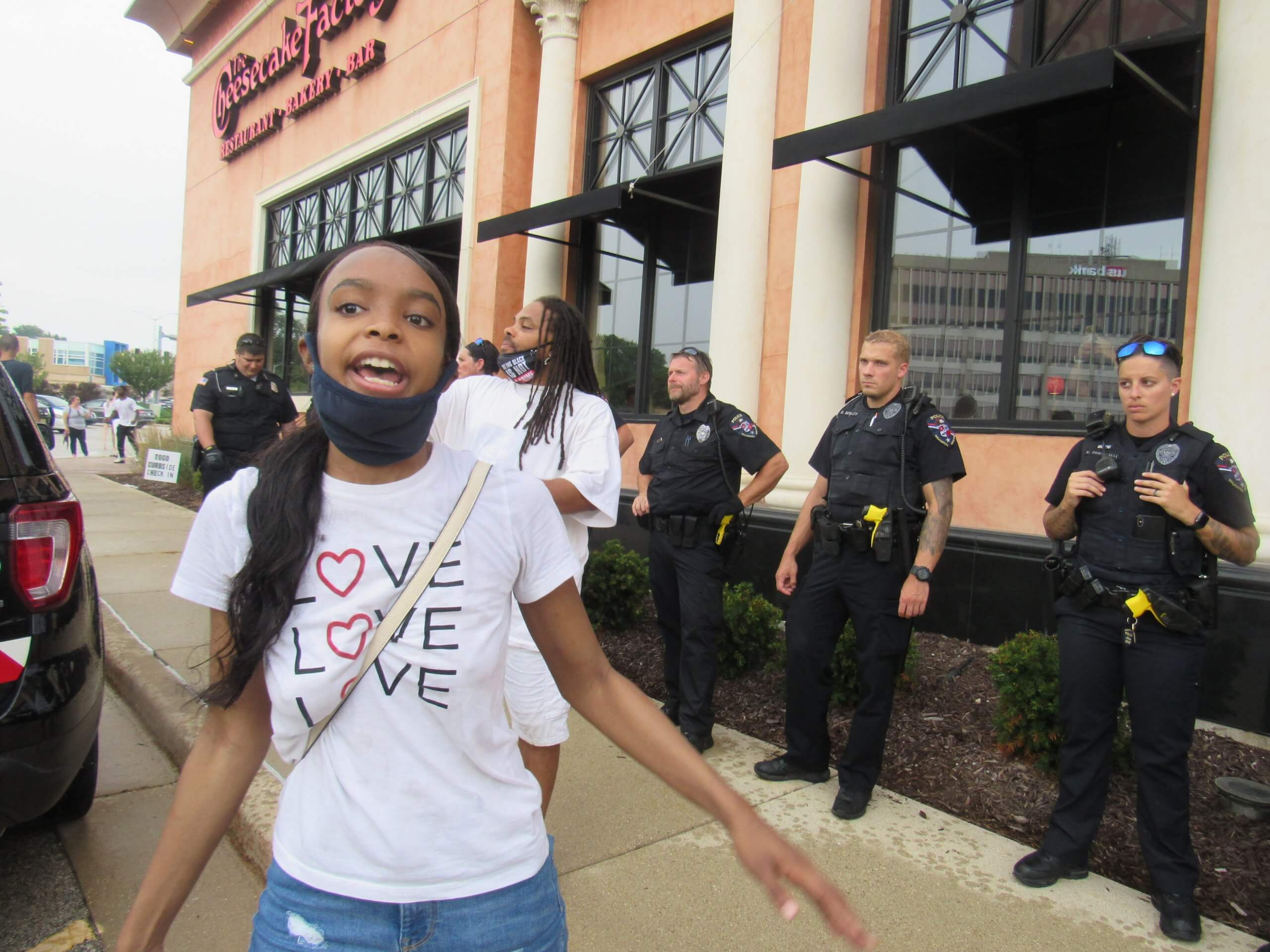 Protesters express their discontent at officers who rushed their protest and arrested several marchers in Wauwatosa. (Photo by Isiah Holmes)