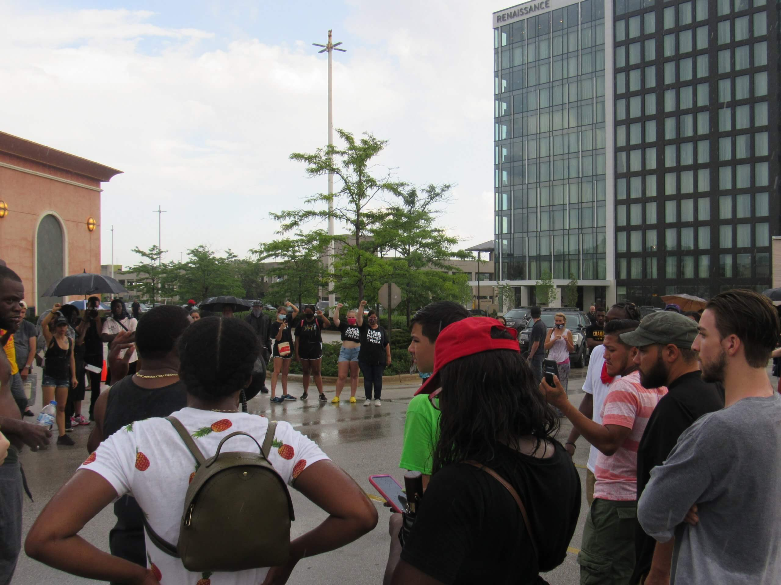 Protesters gather as the scene cools down and the police begin to leave. (Photo by Isiah Holmes)
