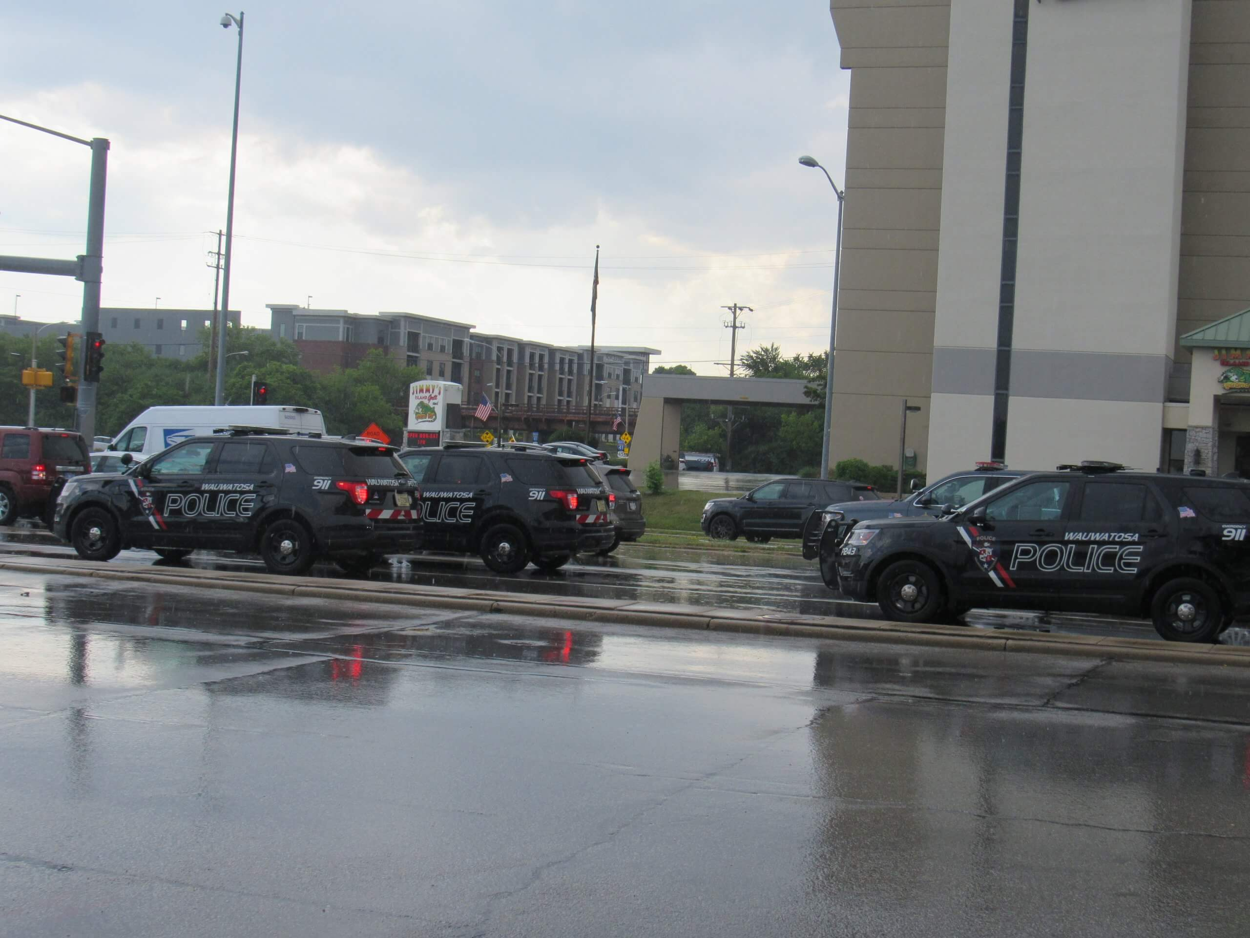 Police units gather and begin rolling out. (Photo by Isiah Holmes)