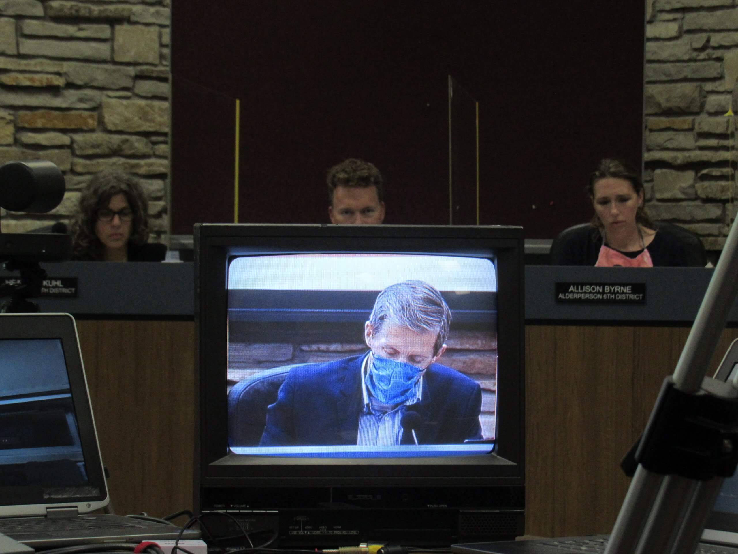 A monitor showing Wauwatosa Mayor Dennis McBride. (Photo by Isiah Holmes)