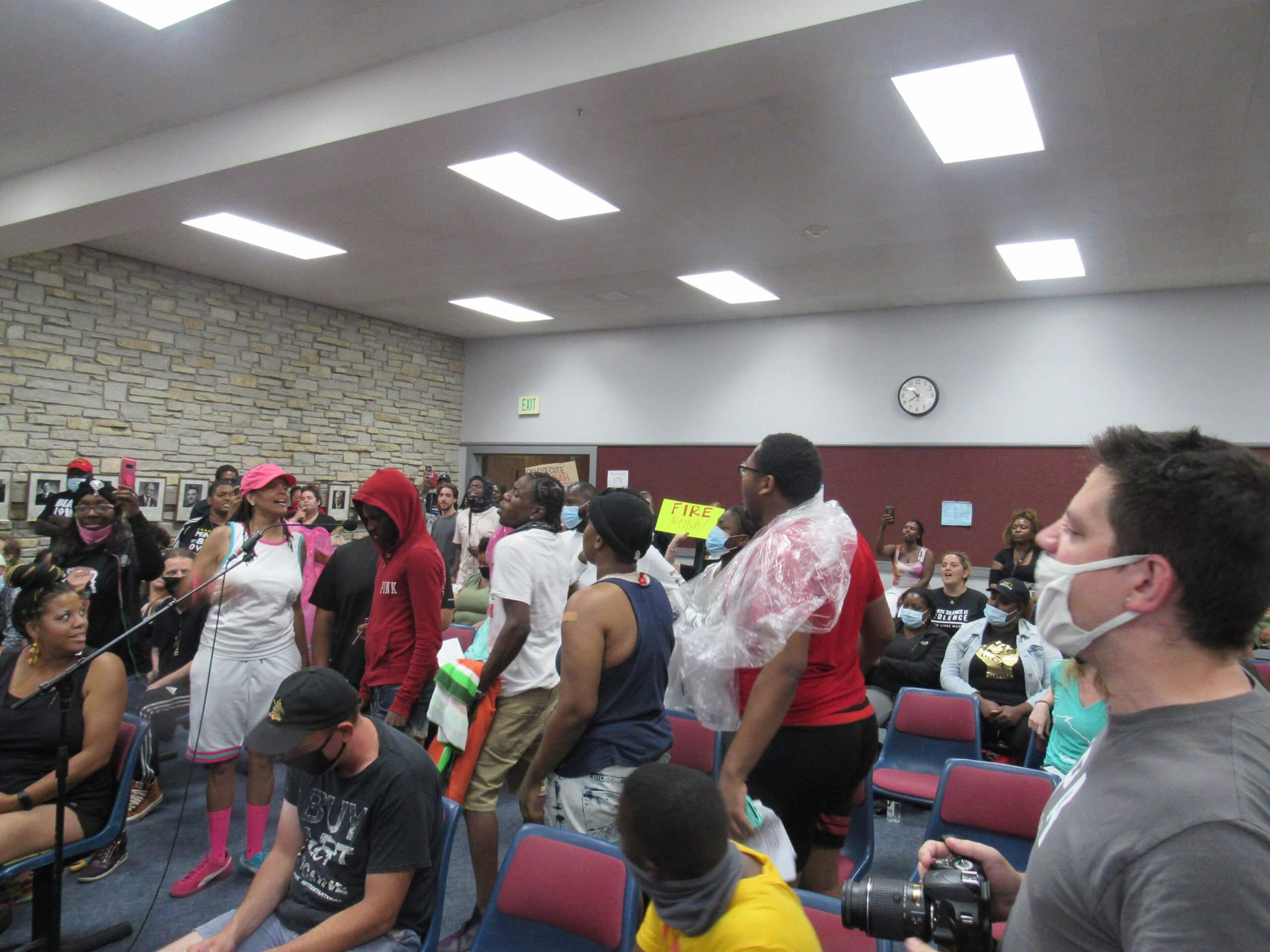 A look at the crowd who'd just left a tense protest where police conducted arrests. They peacefully disrupted the meeting the entire time. (Photo by Isiah Holmes)