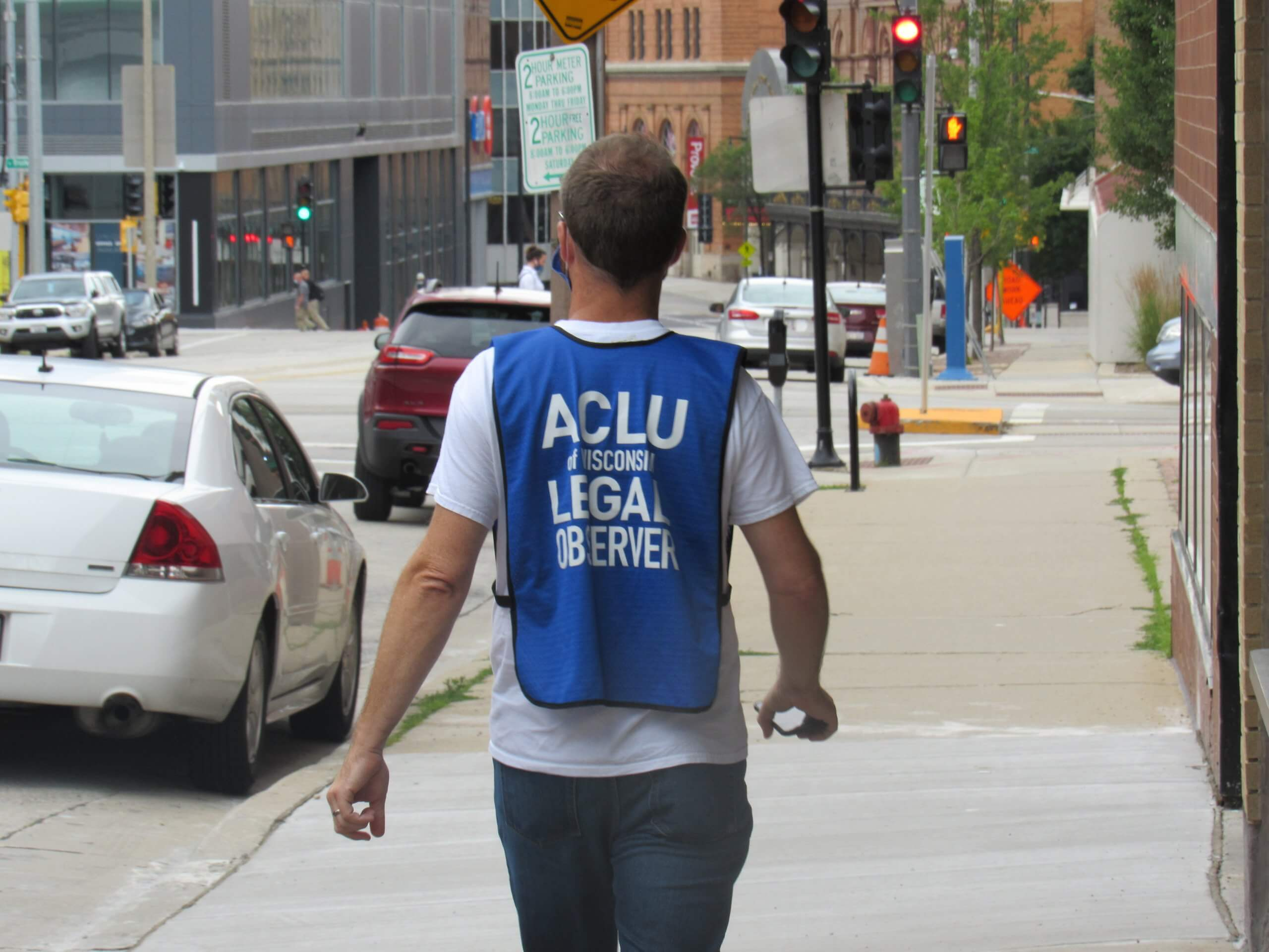 An ACLU legal observer walks and observes the march. (Photo by Isiah Holmes)