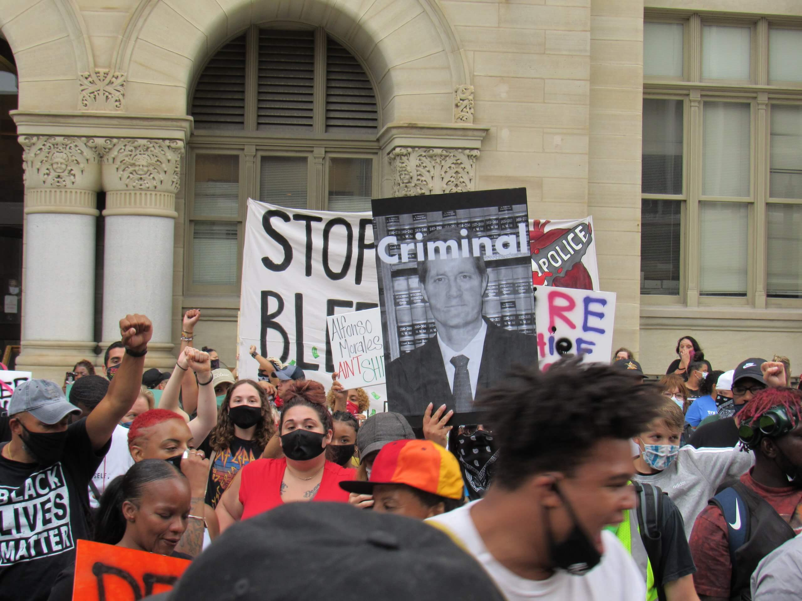 Black Lives Matter protesters gather and march to the Milwaukee City Hall. Many called for the removal of Milwaukee police Chief Alfonso Morales. Calls have been growing against District Attorney John Chrisholm as well. (Photo by Isiah Holmes)