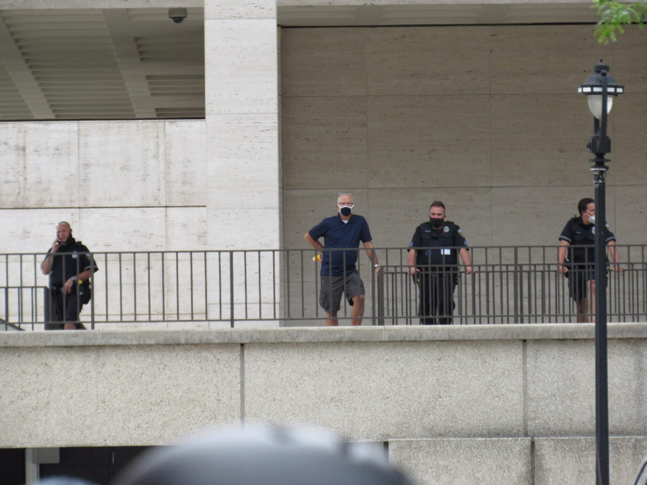 Police offices monitored the event from a distance. (Photo by Isiah Holmes)