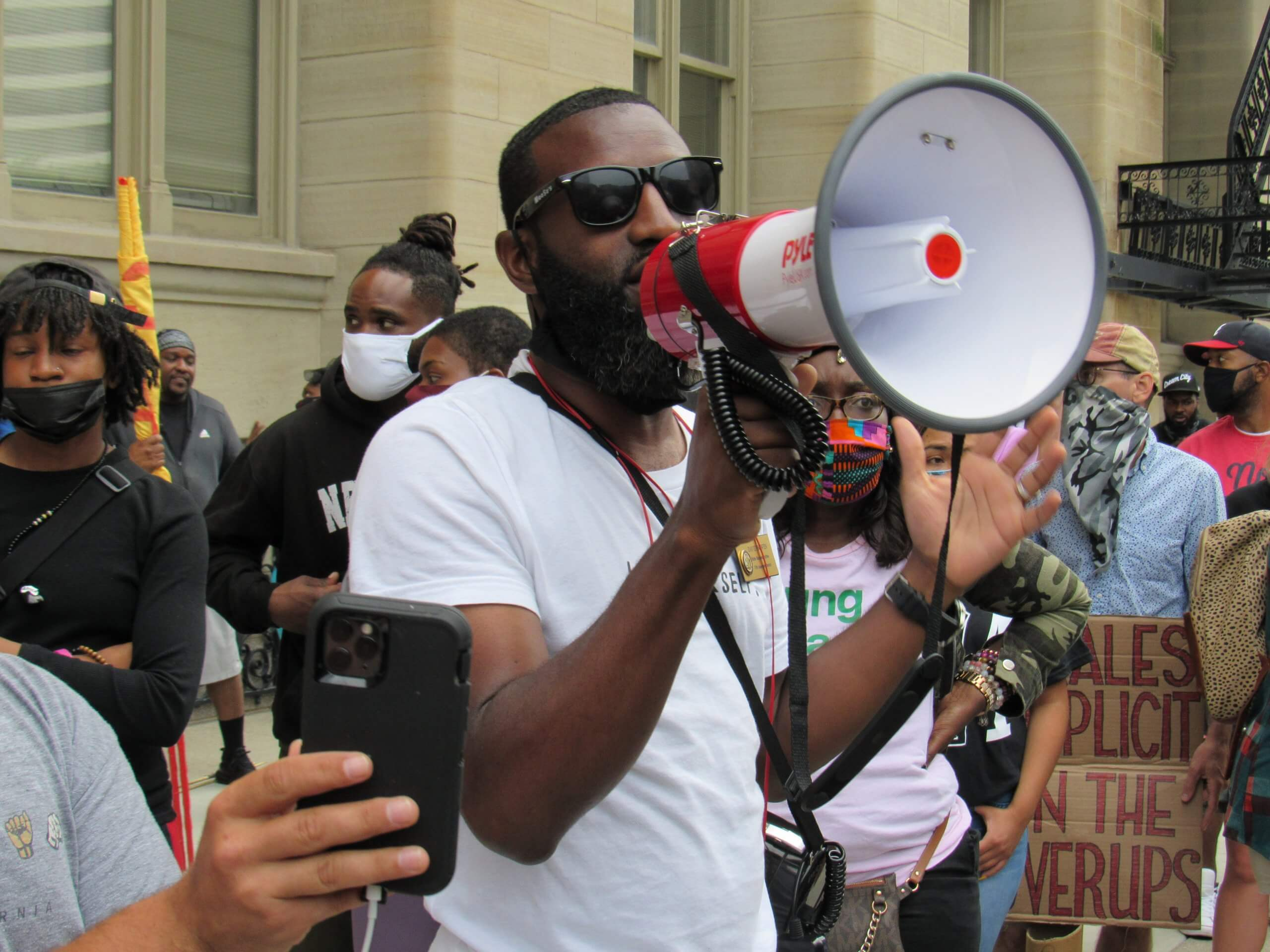 Rep. David Bowen speaks to the crowd gathered in front of Milwaukee's city hall. (Photo by Isiah Holmes)