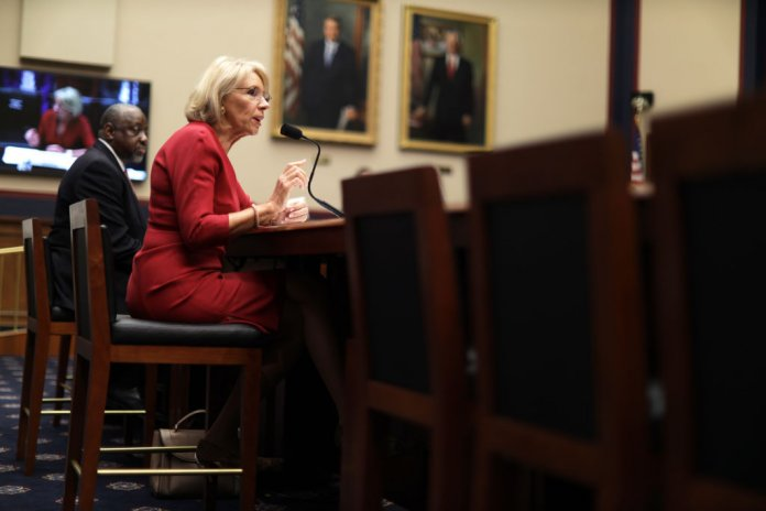 WASHINGTON, DC - DECEMBER 12: U.S. Secretary of Education Betsy DeVos speaks as Chief Operating Officer of Federal Student Aid Mark Brown listens during a hearing before House Education and Labor Committee December 12, 2019 on Capitol Hill in Washington, DC. The committee held a hearing on