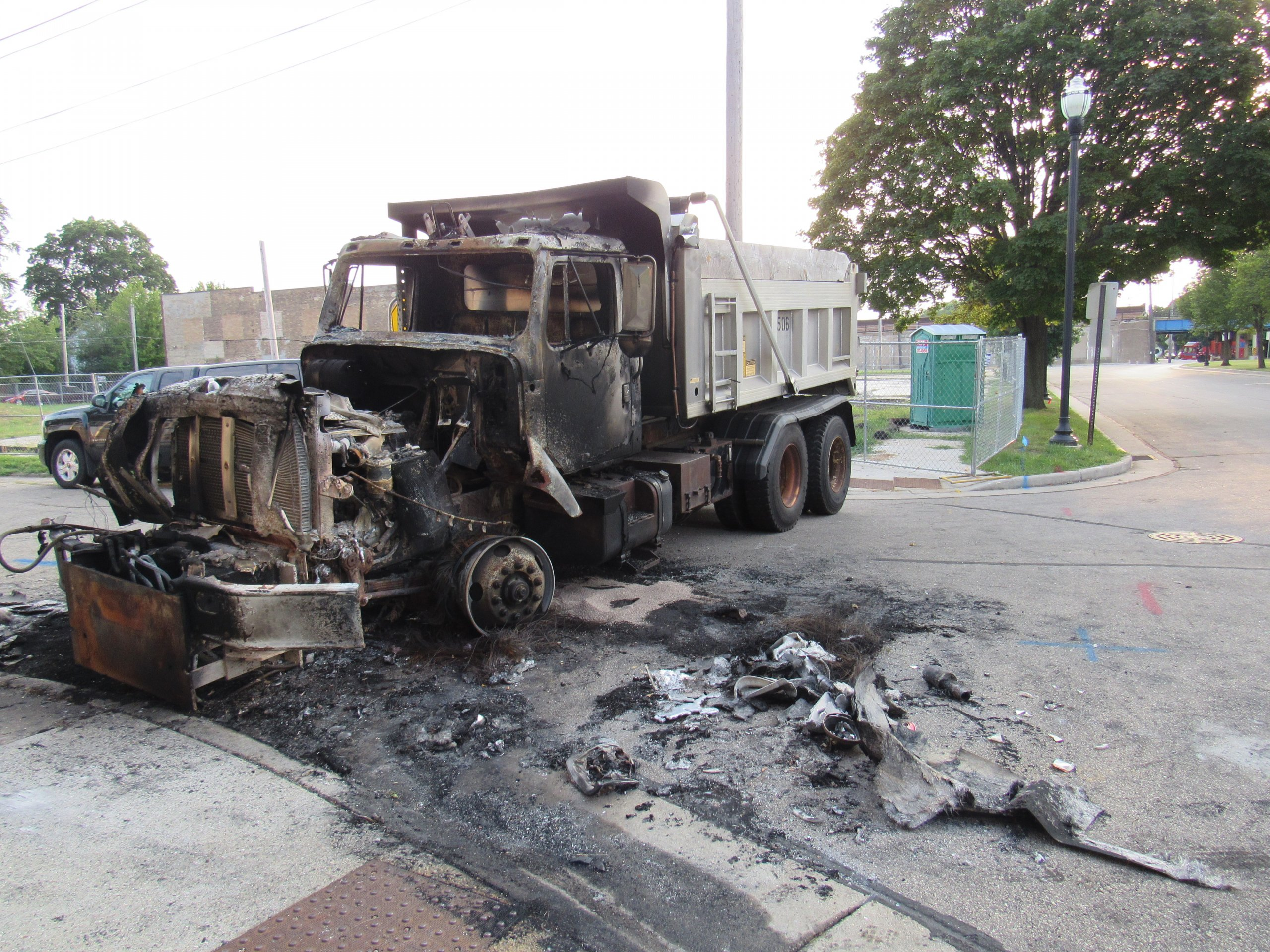 A burned out dump truck in Kenosha. (Photo by Isiah Holmes)
