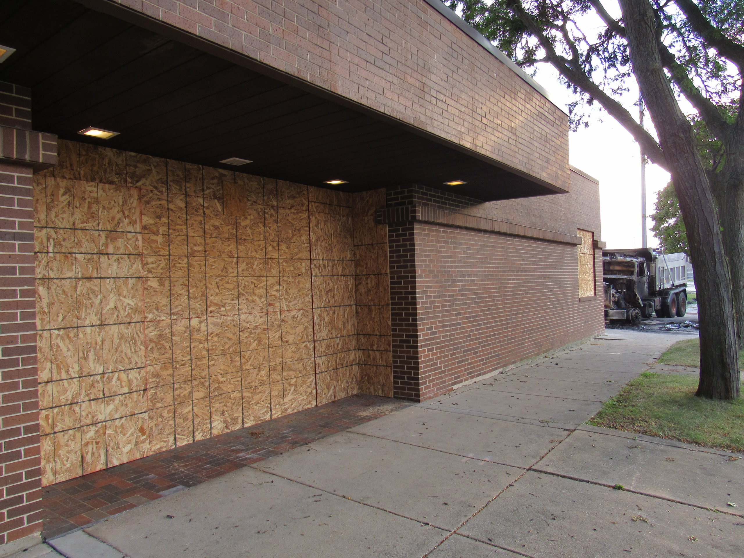 Businesses boarded up their windows and doors either after already having been damage, or to prevent damage. (Photo by Isiah Holmes)