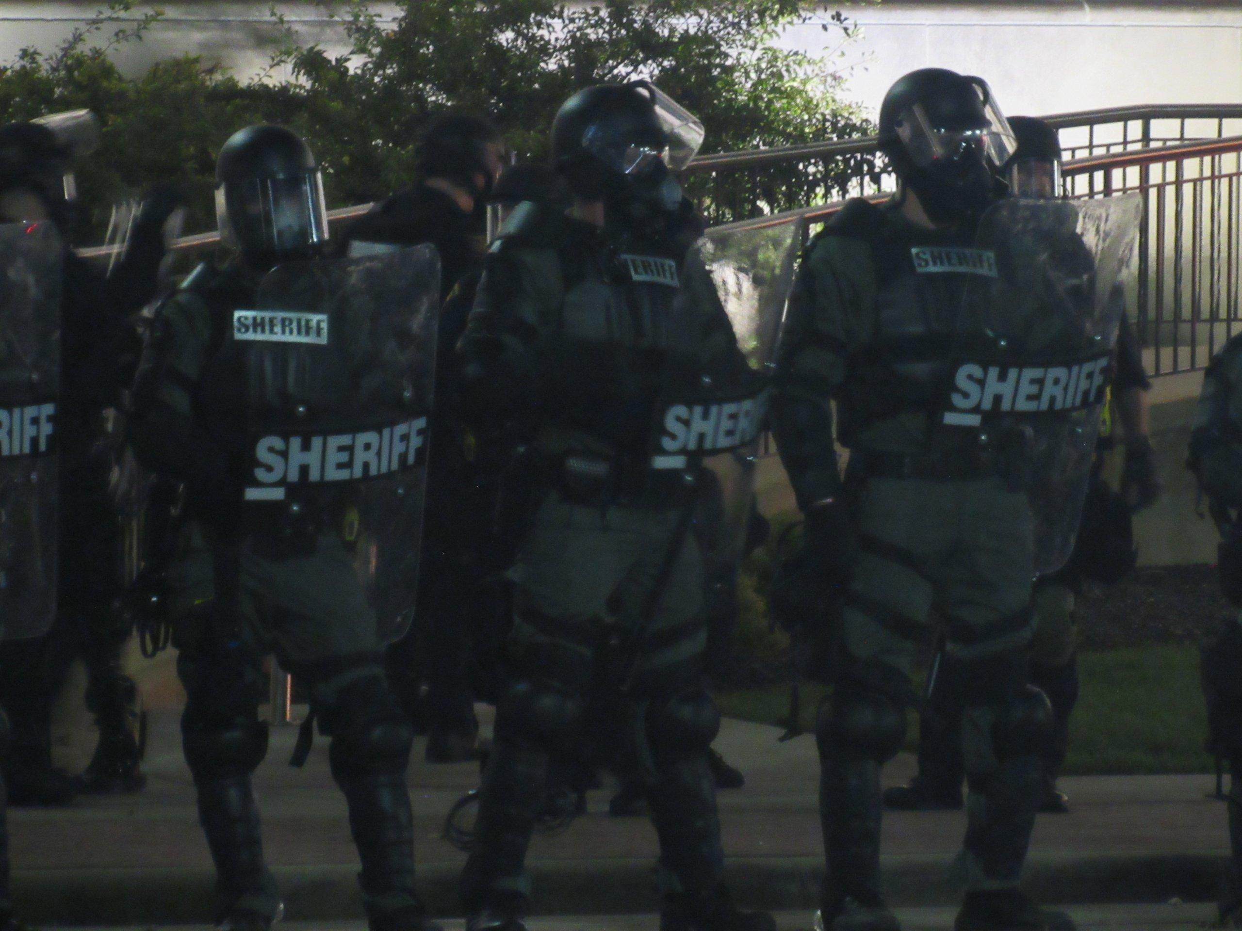 Kenosha County Sheriff's clad in riot equipment form a line in front of city hall. (Photo by Isiah Holmes)