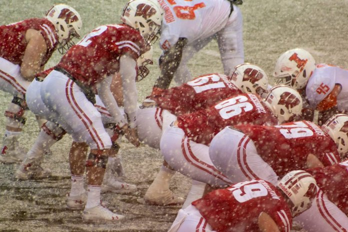 Wisconsin Badgers playing football in the snow