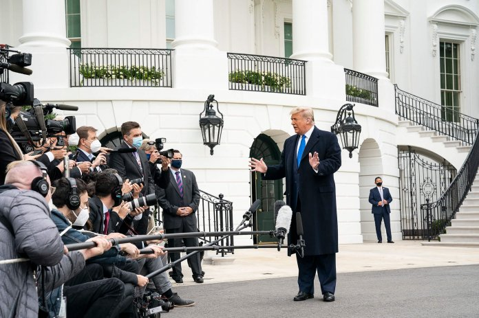 President Donald J. Trump talks to members of the press on the South Lawn of the White House Tuesday, Oct. 27, 2020, prior to boarding Marine One en route to Joint Base Andrews, Md. to begin his trip to Michigan, Wisconsin, Nebraska and Nevada. (Official White House Photo by Joyce N. Boghosian)