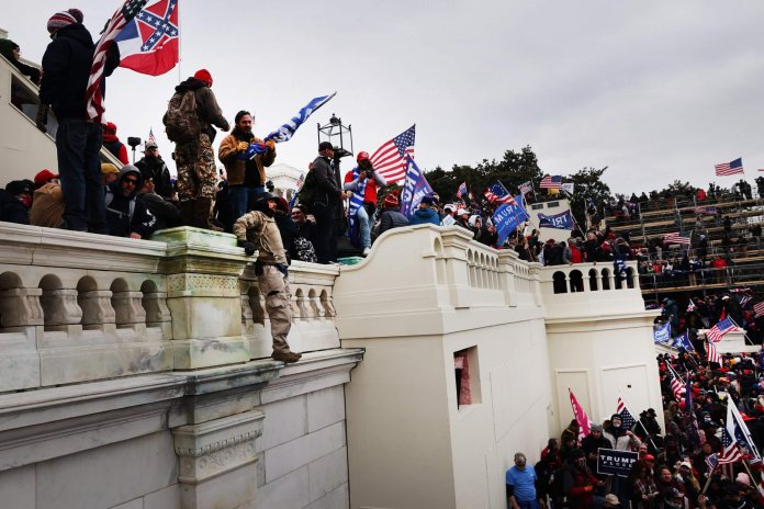 WASHINGTON, DC - JANUARY 06: Thousands of Donald Trump supporters storm the United States Capitol building following a